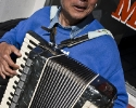 Accordion player in front of Moscow and Tbilisi Bakery Store, 5540 Geary Blvd, San Francisco. Seth Rosenblatt (c) 2010.