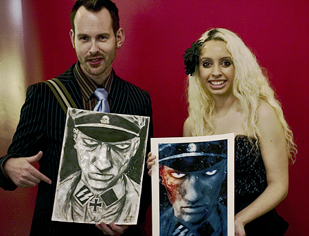 Artist Ben Templesmith, co-creator of the Alaskan vampire horror story 30 Days of Night,  shows off artwork purchased by a fan at Isotope Comics WonderCon 2008 Friday After-Party. Seth Rosenblatt (c) 2008.