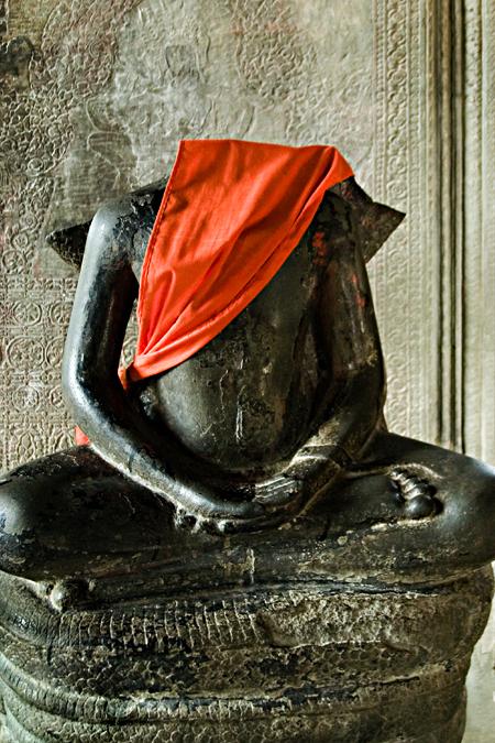 Headless Buddha statue, Angkor Wat, Cambodia. Seth Rosenblatt (c) 2006.