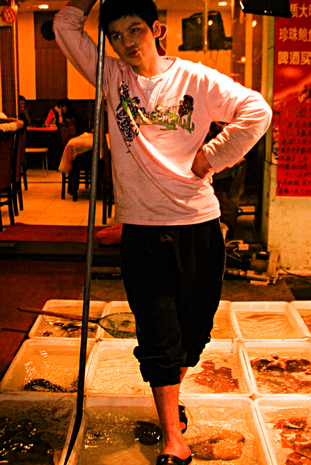 Waiting for customers, Yunnan Lu, Shanghai, China. Seth Rosenblatt (c) 2006.