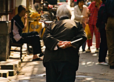 Old woman walking slowly, Jin Jia Fang, Old Town, Shanghai. Seth Rosenblatt (c) 2006.