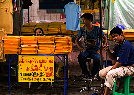 Vendors selling T-shirts commemorating the 60th anniversary of the king's accession to the throne, Bangkok, Thailand. Seth Rosenblatt (c) 2006.