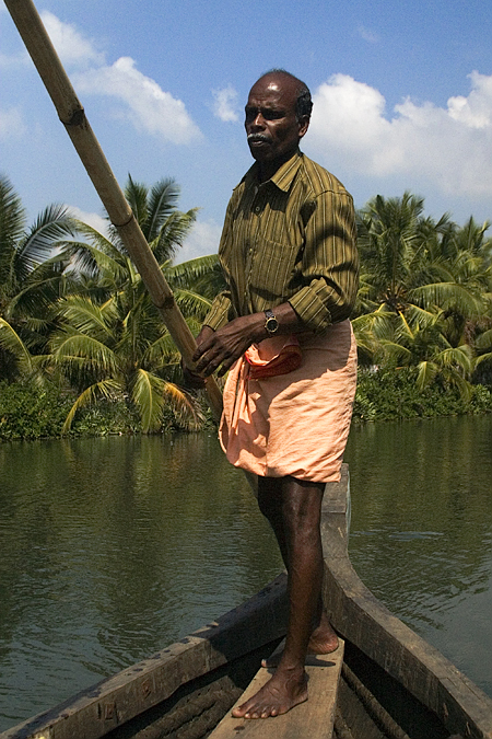 Pushing a water taxi in Kollam beats back-breaking farming, at least for this man in Kerala, India. Seth Rosenblatt (c) 2006.
