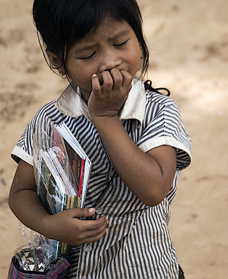 A young girl selling guide books outside Ta Som, Angkor Wat, Cambodia. Seth Rosenblatt (c) 2006.
