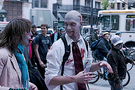 Zombies discussing a hard day at the office as Critical Massers bike past, San Francisco, CA. Seth Rosenblatt (c) 2007.