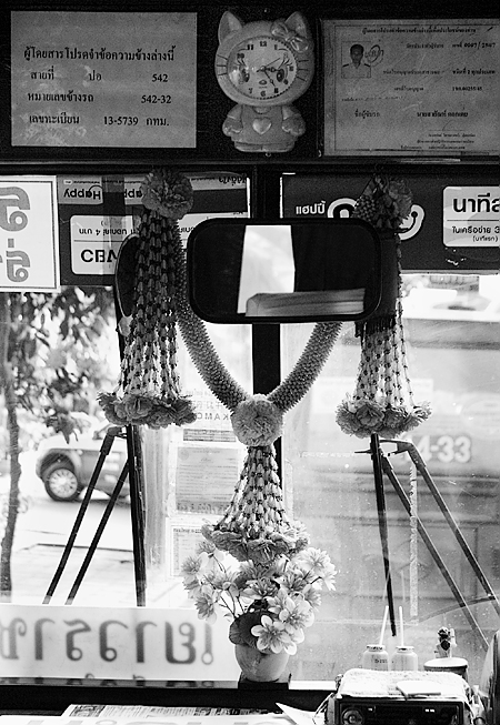 Looking out the front windshield of a public bus, Bangkok, Thailand. Seth Rosenblatt (c) 2005.
